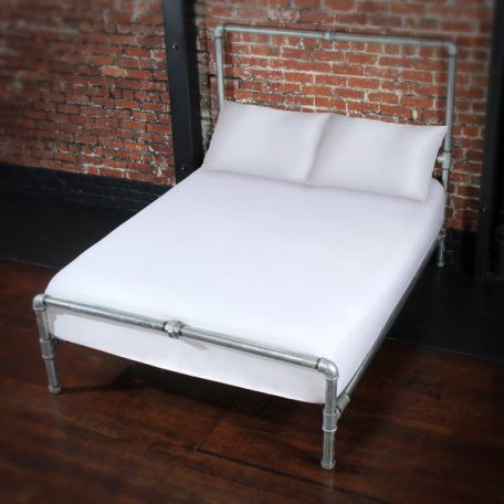 Image of White sheet and pillows on a bed illustrating the post white sheets now available