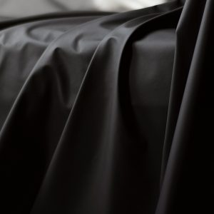 Black Fluidproof sheet draped over a sofa